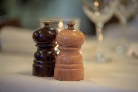 pepper grinder: salt and pepper grinder set on table prepared for luxurious dinner.