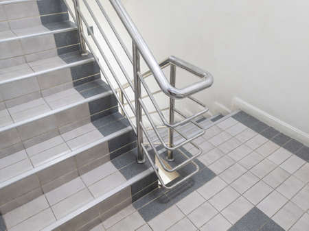 Modern staircase and aluminium railing handle for safety.