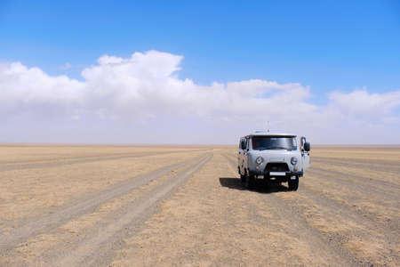 Old van on road Panoramic landscape view at Mongolian gobi desert Mongolia.