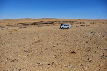 landscape view of Gobi desert with blue sky at Mongolia,goat and sheep background Mongolian. Imagens