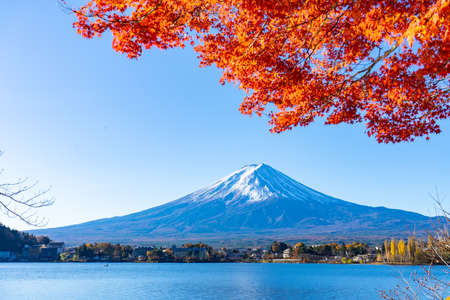 Beautiful Mt.Fuji with red maple leaf in autumn in Japan.