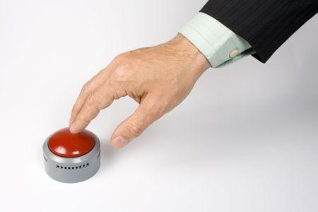 panic button: Un maschio di azionamento a mano uno panico pulsante su una superficie bianca.