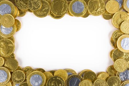 arranged: Chocolate money arranged arround a white frame Stock Photo