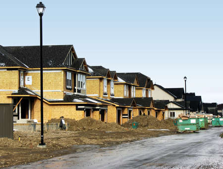 A row of unfinished houses can be used to illustrate construction or even mortgages.