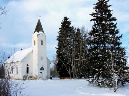 A country church nestled in the trees Stock Photo