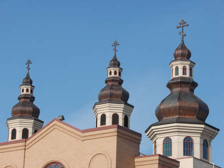 Three domes on stand against a bright blue sky. Stock Photo