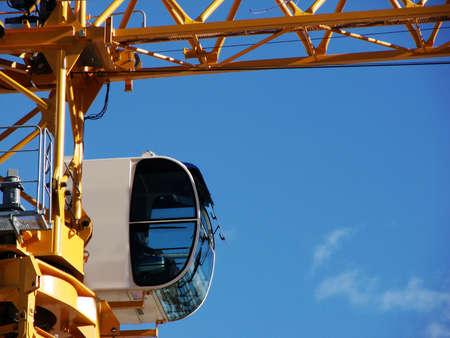 A closeup shot of a crane cab. Ideal for construction advertisement