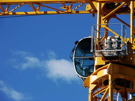 A different angle of a crane against a clear blue sky.