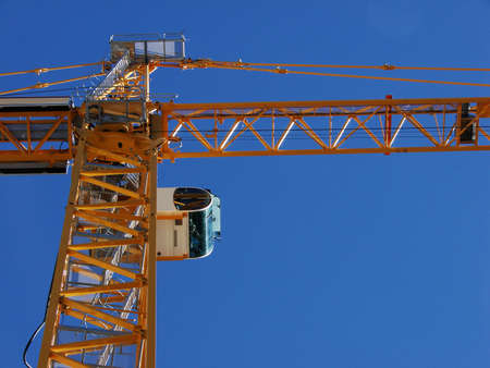 A dynamic angle looking at the bottom side of a crane. Stock Photo