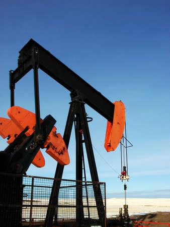 A pump jack stands alone on the prairies.