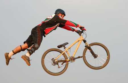 daredevil: Guy on mountain bike taking big jump, no ground visible