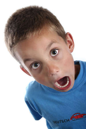 bright eyed: Young boy in bright clothing portrait shot wide eyed and open mouth