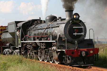arriving: Steam locomotive arriving Stock Photo