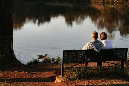 lasting: Old couple feeding ducks