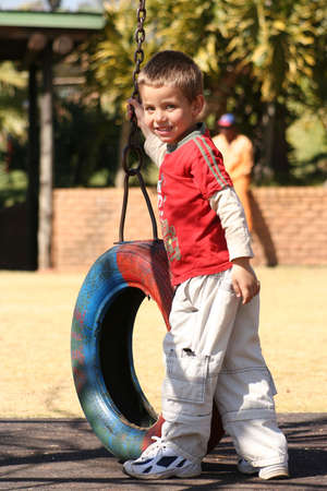 Boy playing in park photo
