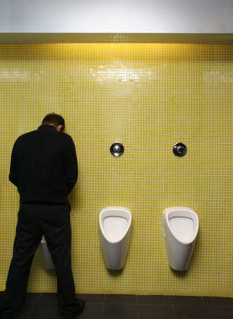 urinal: Guy standing at the urinals