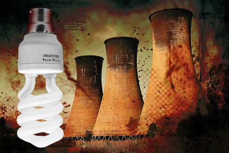 Coal powerstation with heavy grunge effect and energy saving bulb. Global warming concept. photo