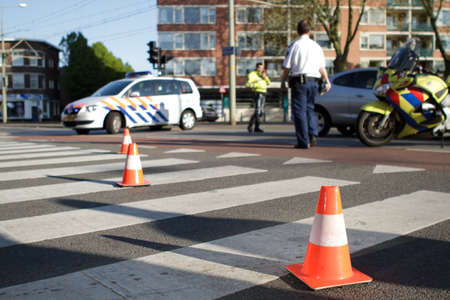 motorcycle officer: Accident scene. Traffic cones. Stock Photo