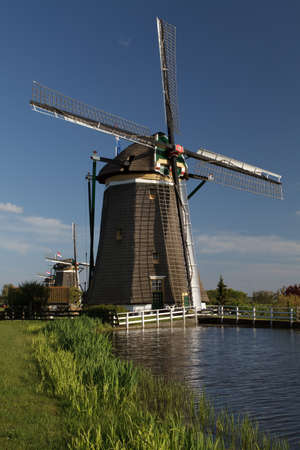 Traditional windmills  on the country side of Holland photo