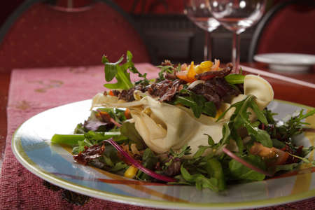 Salad served on a plate. Prepared by a professional chef. photo