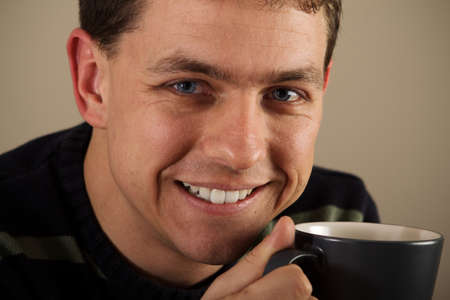 tea break: Portrait of man drinking hot beverage. Relatively short DoF. Sharp face, eyes.