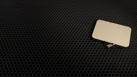laser cut plywood 3d symbol of rectangular chat bubble render on metal honeycomb inside laser engraving machine background