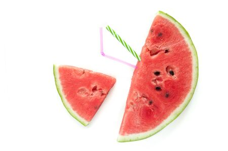 Slices of juicy ripe red watermelon on a white background. Fresh watermelon juice. Cocktails and soft drinks with watermelon.