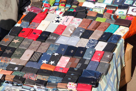flew: Colorful Money Purses on a Flew Market Stall