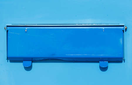 mail slot: blue colored letterbox with mail slot Stock Photo