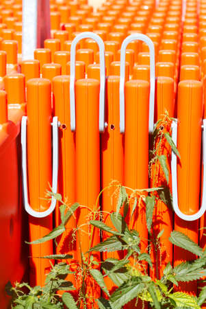 orange planks of a construction Barrier Stock Photo
