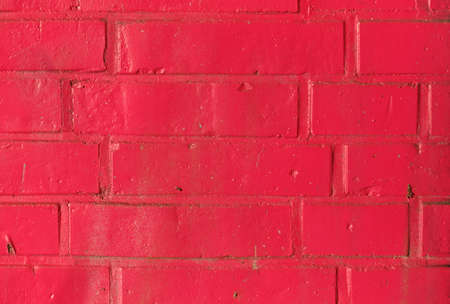 red wall: red painted brick wall