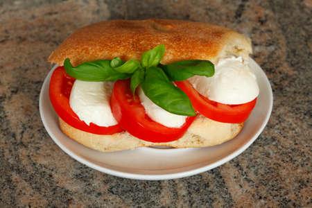 chese: Ciabatta Bread Sandwich with Tomatoes and Mozzarella Chese Stock Photo