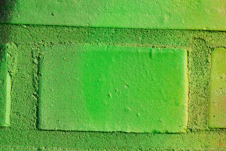 green painted brick wall