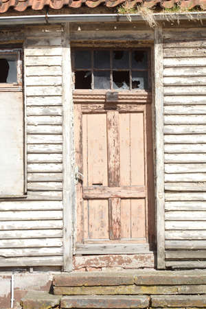 old door on an old condemned wooden house