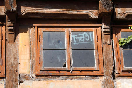 old windows on an old condemned wooden house