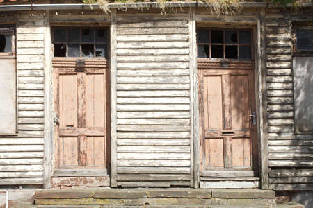 old doors on an old condemned wooden house