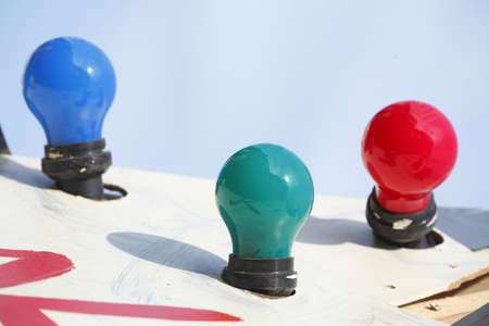 colorfully: colorfully electric light bulbs with blue sky