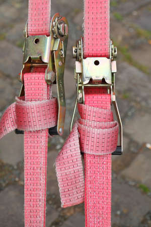 pink colored ratchet lashing strap