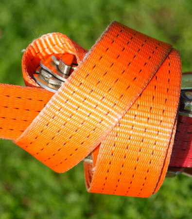 orange colored ratchet lashing strap