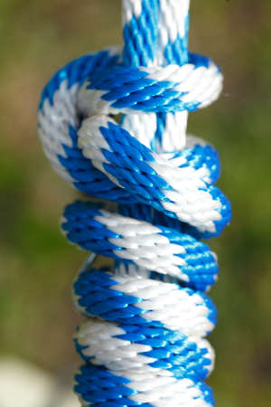 blue white colored rope with knot