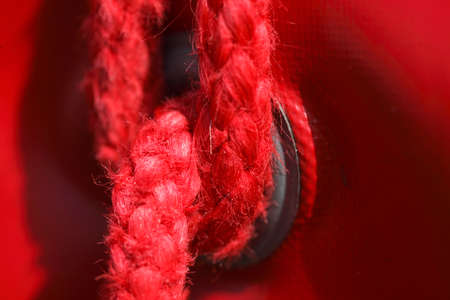 red  colored rope on a tent