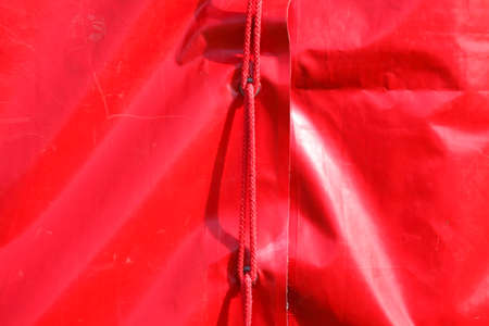 red tent tarpaulin from a tent  Stock Photo