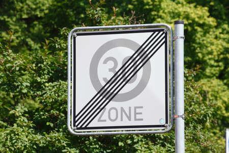 road sign end of aspeed limitation thirty kilometers zone Reklamní fotografie - 83014655