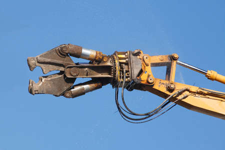Demolition Excavator with Blue Sky