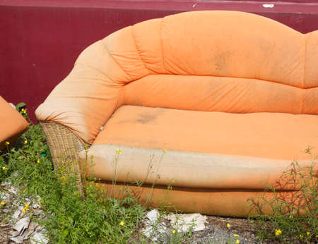 An old orange couch for bulky refuse collection