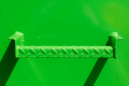 pus: green metal step on a green metal wall