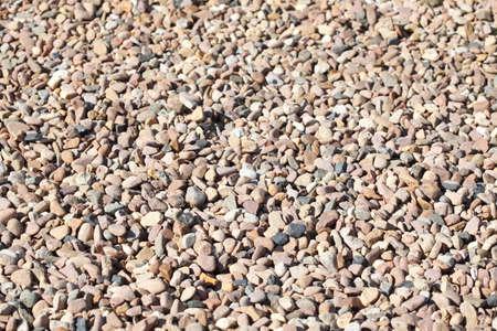 brown little grit stones as floor covering