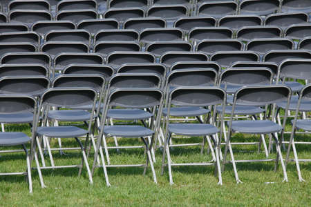plastic chairs, grey chair row on a festival