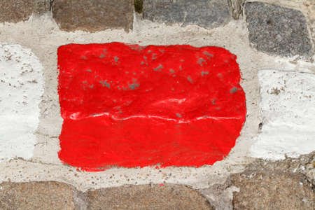 red  colored stone  kerb on the street