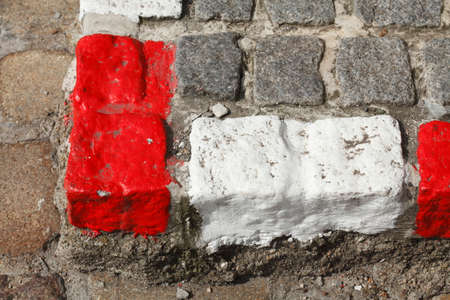 red and white colored stone  kerb on the street